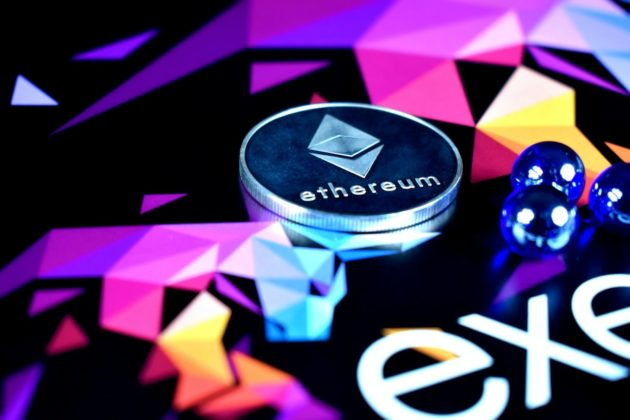 Ethereum token is illustrated as a physical coin with colorful background