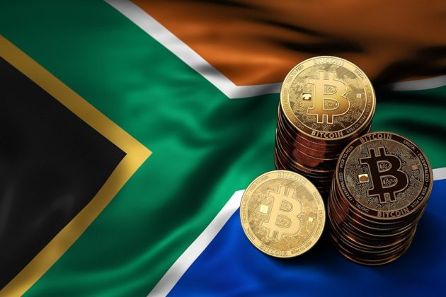 Bitcoin is illustrated as physical gold coin with South Africa's national flag on the background