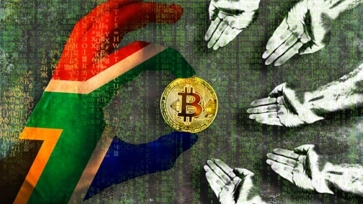 A hand painted in South Africa's national flag color is holding a physical Bitcoin with other hands